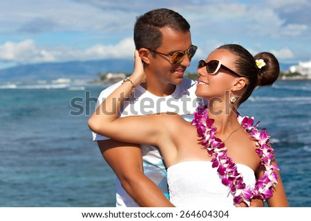 Young couple relaxing together enjoying their holidays in perfect getaway in sunny tropical destination. Couple in love, summer luxury vacation in Hawaii. Living, loving and laughing - stock photo