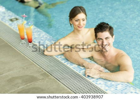 Young couple relaxing together in the pool
