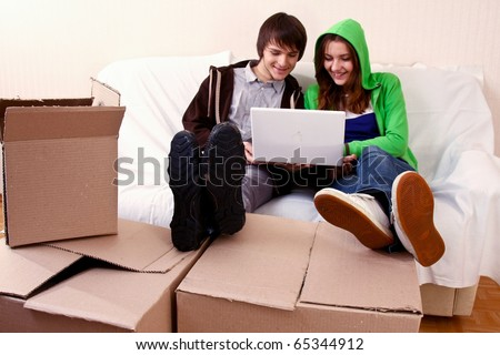 Young couple resting from moving into a new home - stock photo