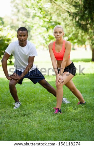 young couple runner jogger in park outdoor summer sport lifestyle  - stock photo