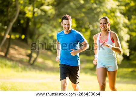 Young couple running - stock photo