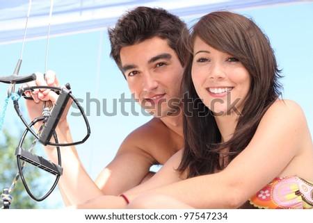 Young couple sailing a catamaran - stock photo