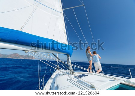 Young couple sailing in Mediterranean sea at sunny day - stock photo
