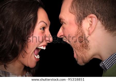young couple screaming at each other