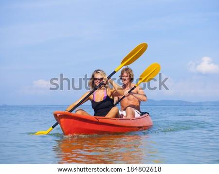 Young couple sea kayaking. - stock photo