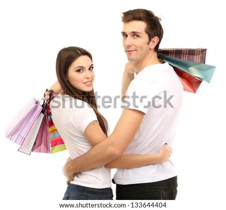 Young couple shopping and holding many shopping bags isolated on white - stock photo