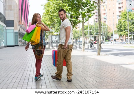 Young couple shopping at a department store - stock photo
