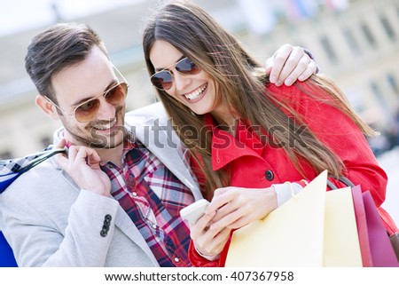 Young couple shopping in the city - stock photo