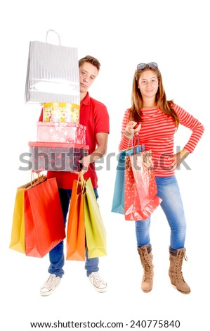 young couple shopping isolated in white - stock photo