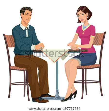 young couple sitting at a table in a cafe - stock photo