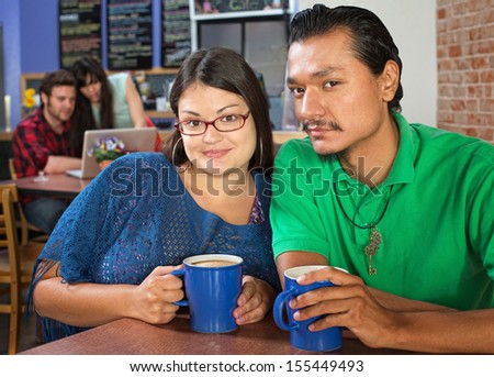 Young couple sitting in a coffee house