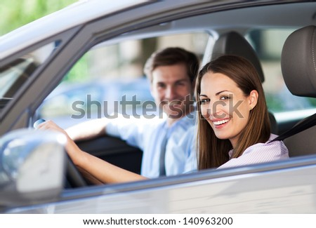 Young couple sitting in car - stock photo