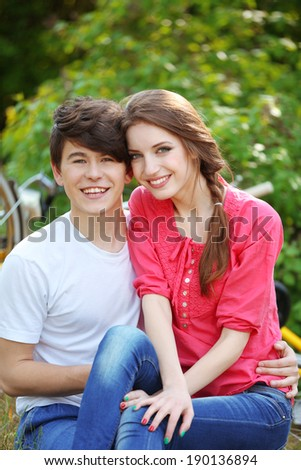 Young couple sitting in park