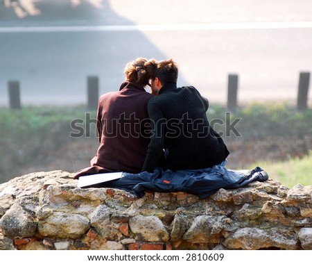 Young couple sitting on hill