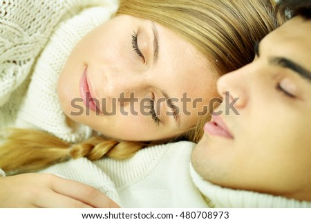 Young couple sleeping together, the focus is on the girl