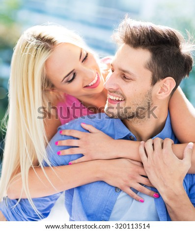 Young couple smiling - stock photo
