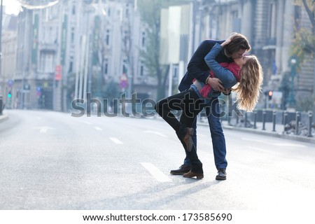 Young couple smiling and having fun outdoors on a date. - stock photo