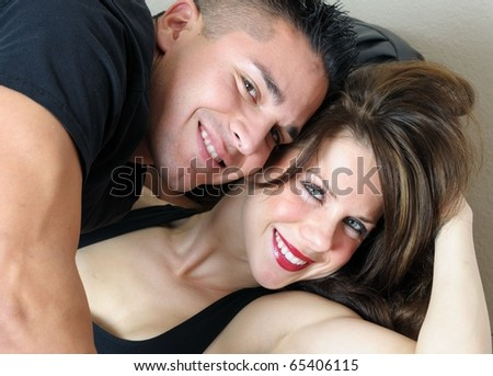 Young Couple Smiling and showing affection. - stock photo