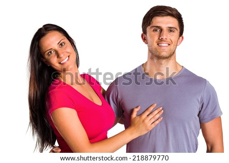 Young couple smiling at the camera on white background