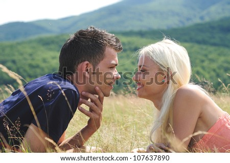 Young couple smiling in nature
