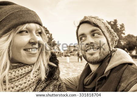 Young couple smiling outdoor - Happy friends facial expression for reconciliation - Closeup faces of young lovers - Concept of youth and human moods - Sunset light and black and white retro filter - stock photo