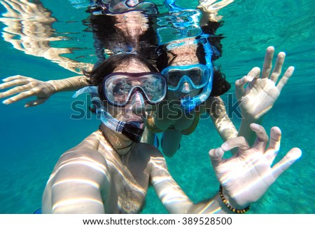 Young couple snorkeling in the honeymoon - stock photo