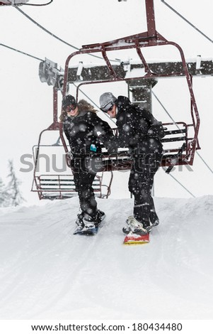young couple snowboarding in northern Idaho with snowy conditions - stock photo