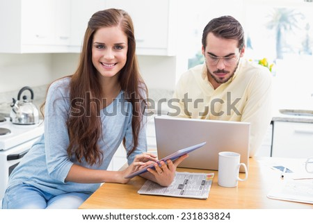 Young couple spending time together at home in the kitchen - stock photo