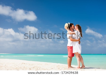 Young couple standing at beach during summer vacation