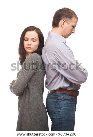 Young couple standing back to back having relationship difficulties. Isolated on white background - stock photo