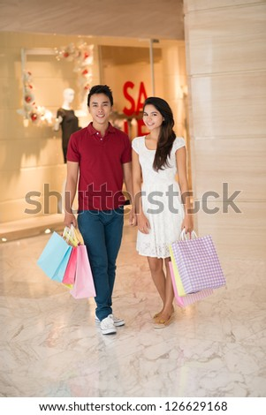 Young couple standing in the store