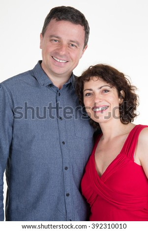 Young couple standing on a white background - stock photo