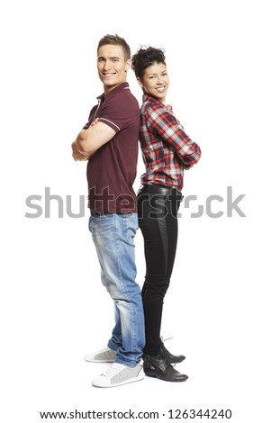 Young couple standing together smiling on white background smiling