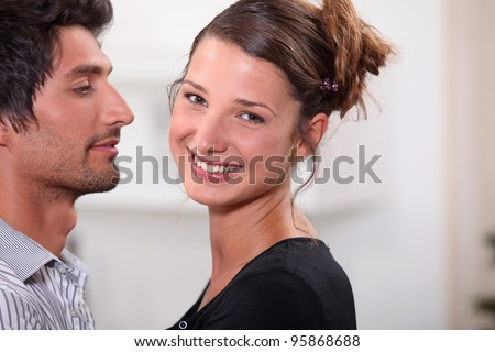 Young couple stood at home - stock photo