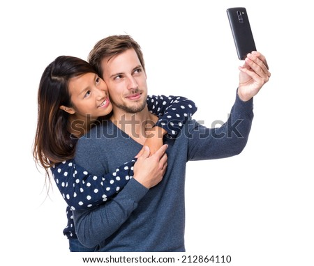 Young couple take selfie - stock photo