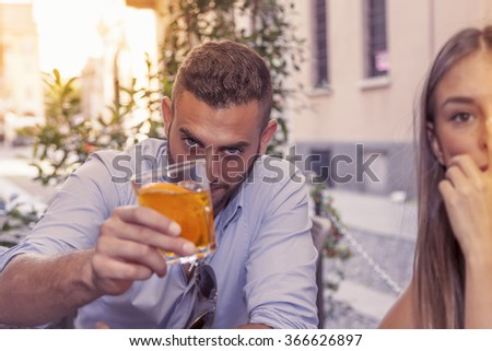 young couple takes a drink in a downtown bar