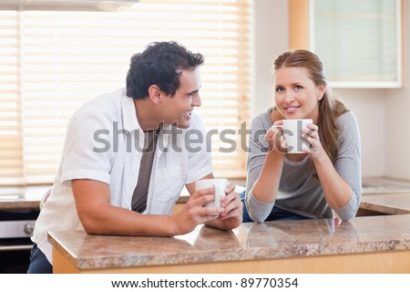 Young couple taking a coffee break together - stock photo