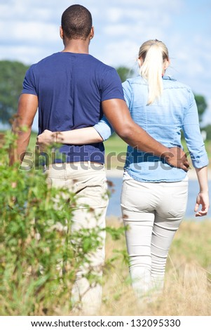 Young couple taking a walk outside. - stock photo