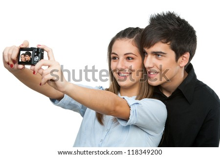 Young couple taking self portrait with camera.Isolated on white.