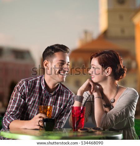 young couple talking and enjoying  beverages - stock photo