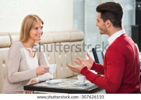 Young couple talking in a cafe