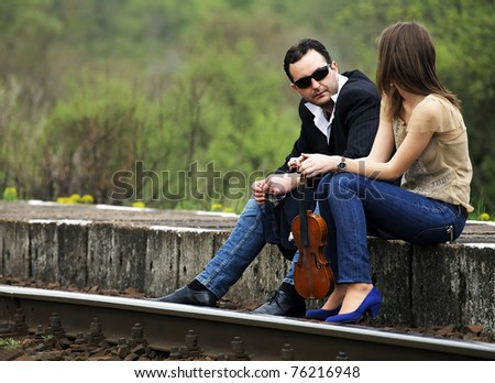 Young couple talking in a railway station