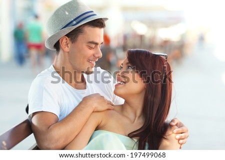 Young couple talking to each other, smiling and enjoying time together