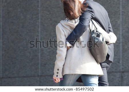 Young couple. The business man and the business woman after work. Motion blurred. - stock photo