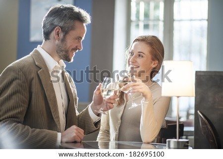 young couple toasting in a bar - stock photo