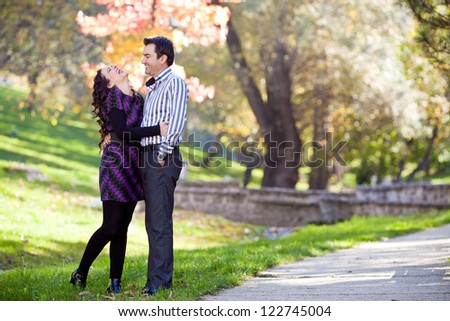 young couple together at a mark - stock photo