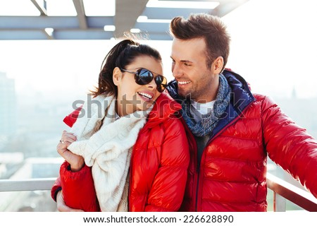 Young couple together at rooftop smiling - stock photo