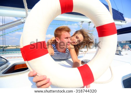young couple traveling on a yacht - stock photo