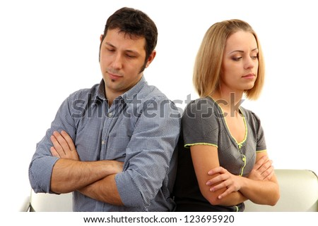 Young couple turning away from each other isolated on white - stock photo