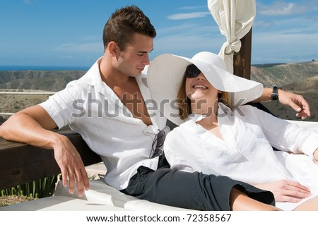 young couple under the sun in spring or summer - stock photo